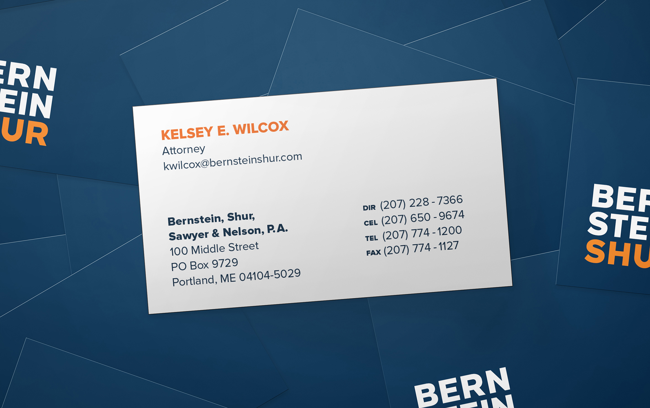 Close ups of the front and back of Bernstein Shur business cards.