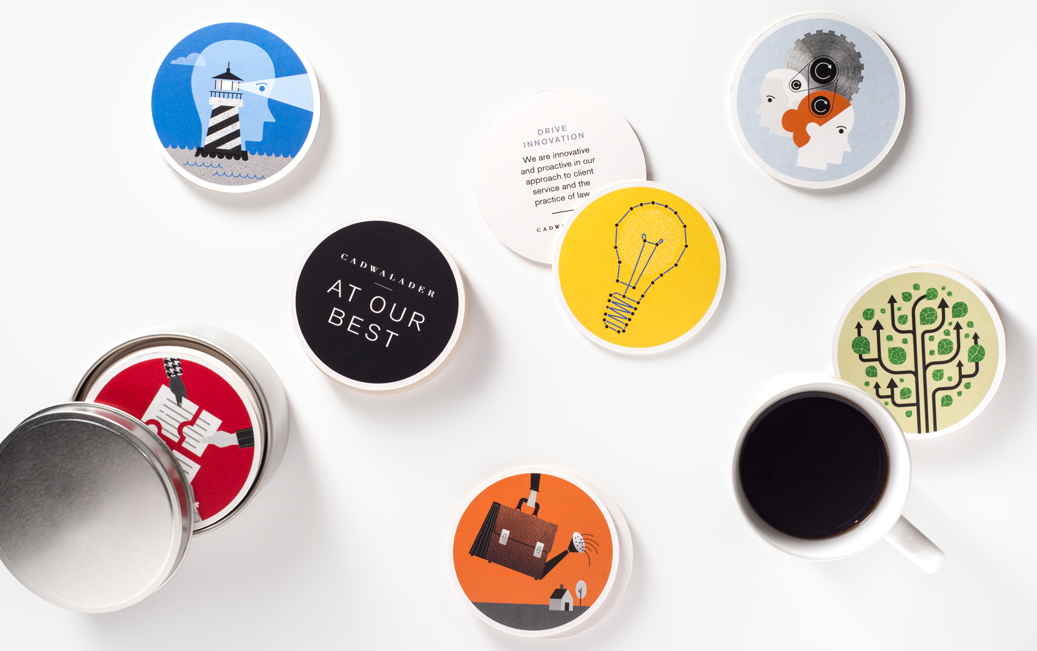 """Several drink coasters with illustrationa the message """"At our best"""" and """"Drive innovation scattered on a tabletop."""