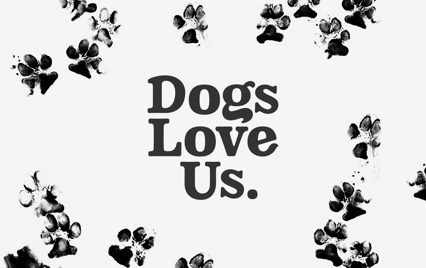 Black and white Dogs Love Us logotype with inked paw prints in the background.