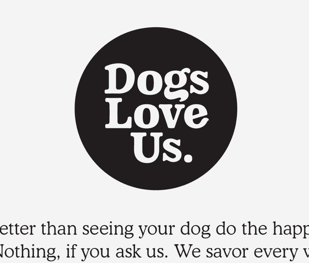 Close up of Dogs Love Us logo with white typed dropped out in a black circle.