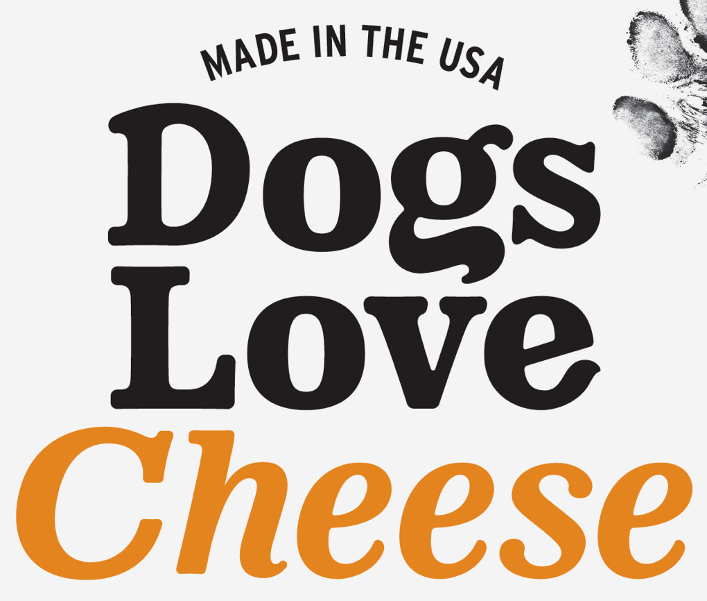 "Close up of Dogs Love Us cheese treat package with the phrase ""Made in the USA"" and an inked paw print in the background."