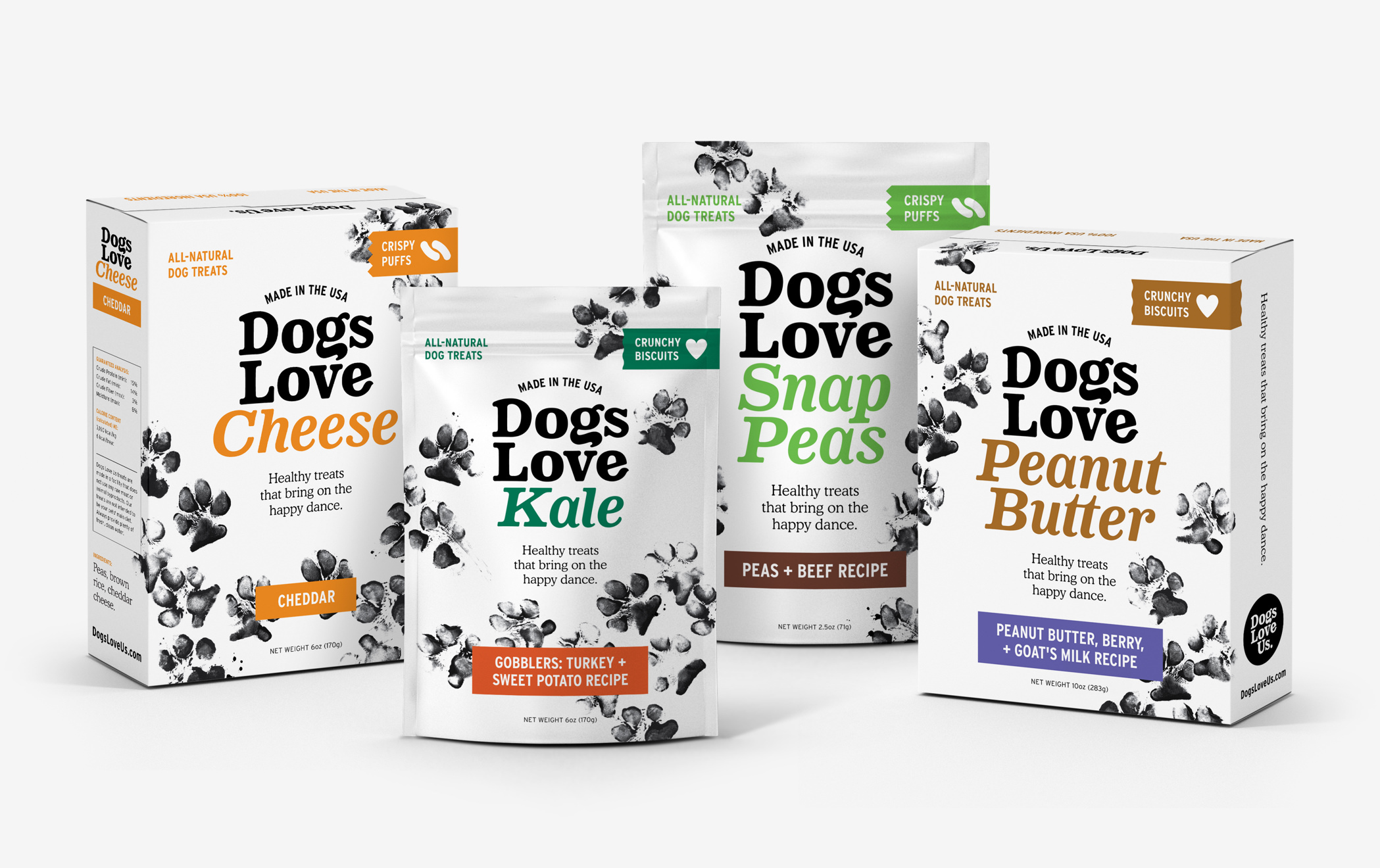 Four packages of Dogs Love Us treats, including cheese, kale, snap peas, and peanut butter flavors.