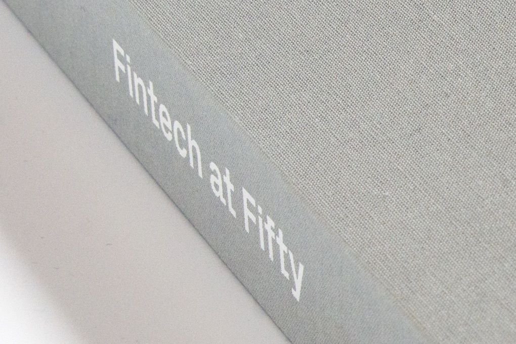 """Fintech at Fifty"" printed on the spine of the linen covered custom case for Instinet's 50th anniversary graphic novel."