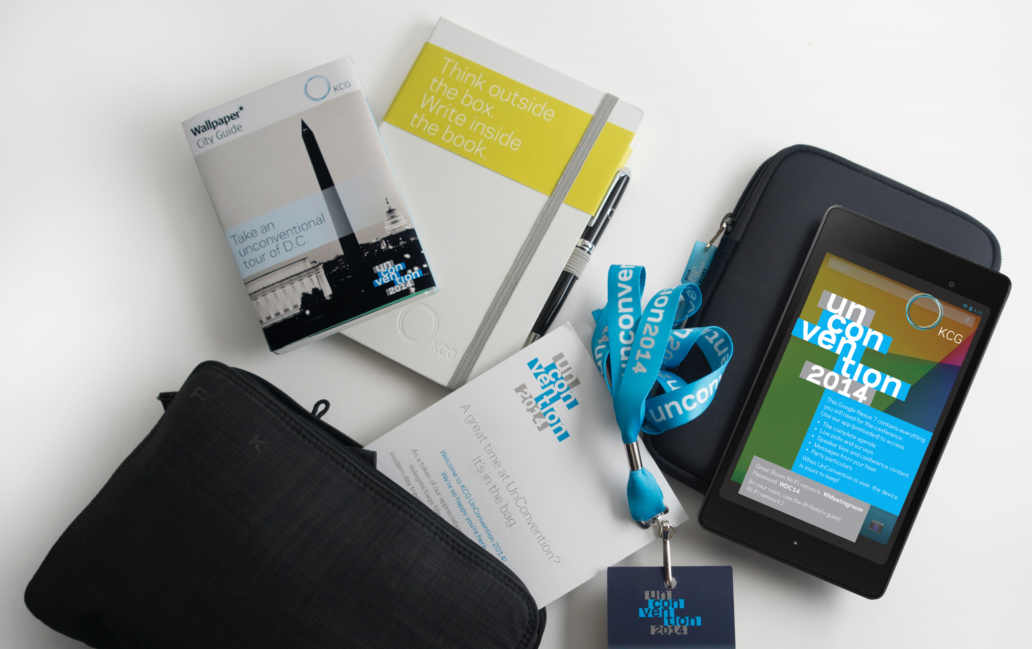 Several giveaway items from the 2014 KCG Uncon client event, including a digital table and map of Washington, DC.
