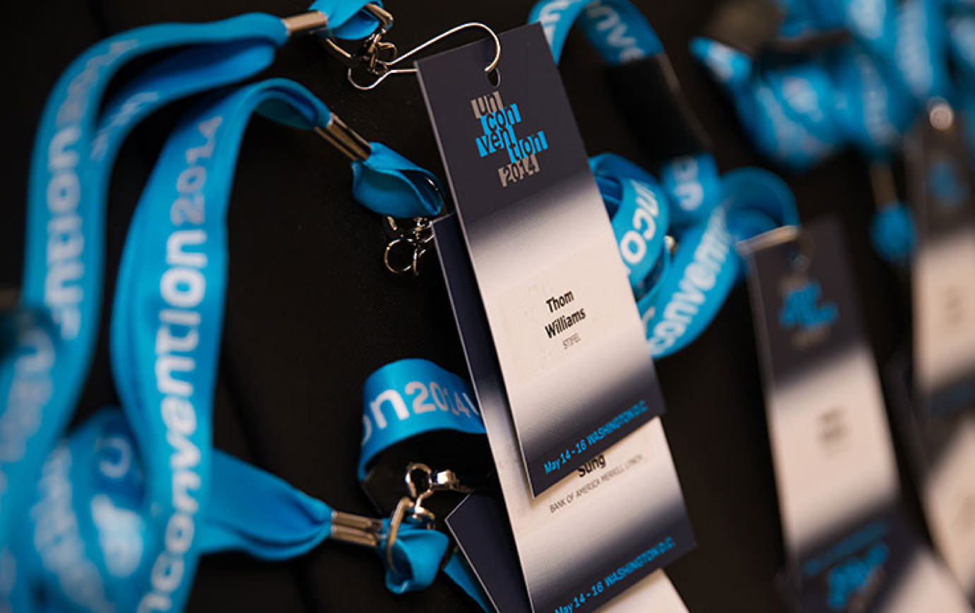 Close up of a stack of 2014 KCG Uncon client event attendee credentials on lanyards.