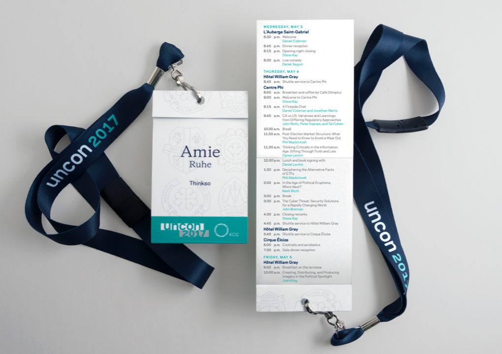Close up of the 2017 KCG Uncon client event credentials and schedule care on lanyards.