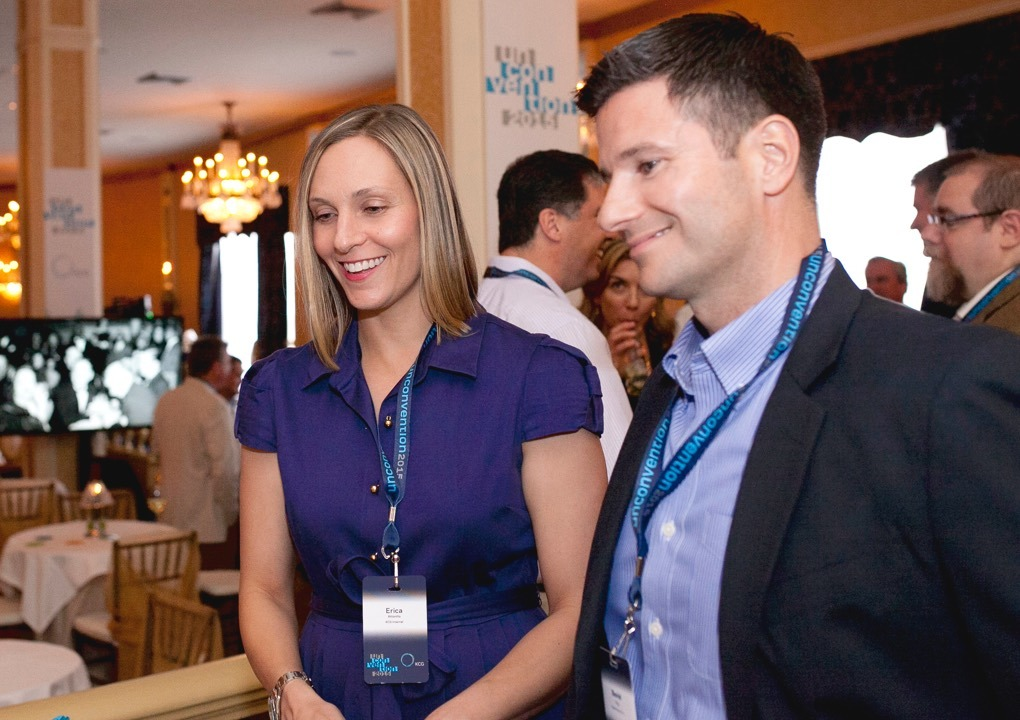 Close up if two 2015 KCG Uncon client event attendees enjoying a conference reception.
