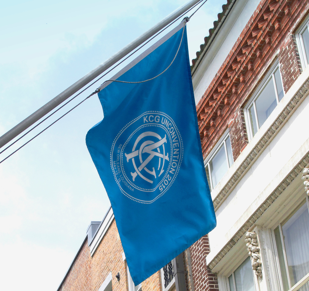 A large blue flag with the 2015 KCG Uncon client event logo flies outside the conference facilities.