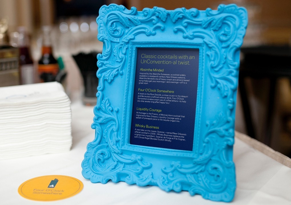 2015 KCG Uncon client event dinner menu card in am ornate blue table-top frame.
