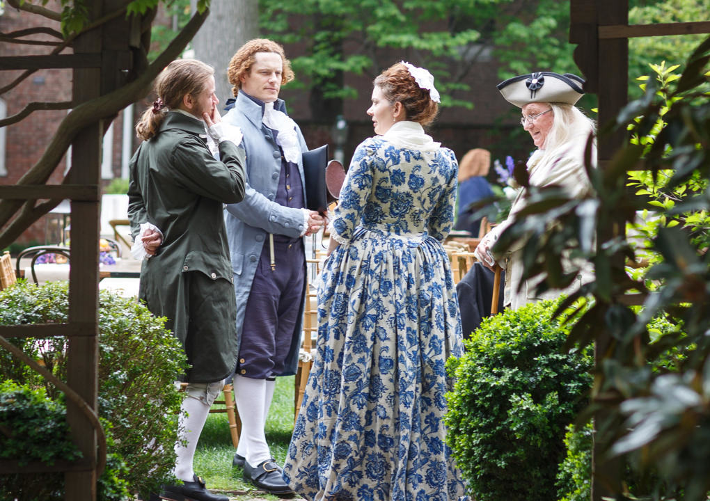 Actors portraying revolutionary era historical figures mingle at an outdoor reception at the 2016 KCG Uncon client event.