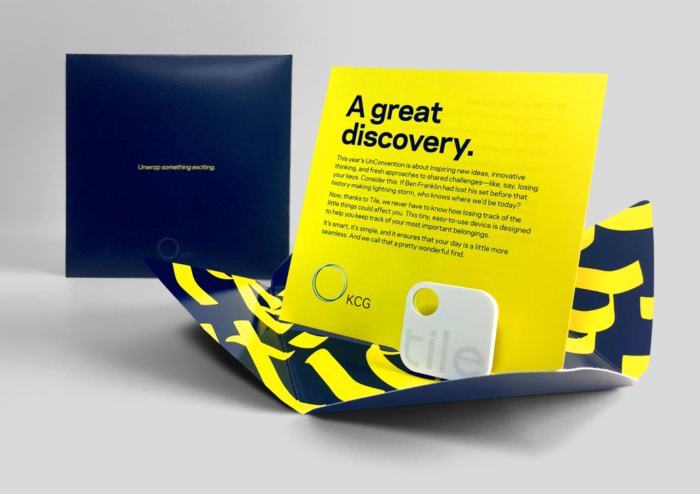 """An open package for a giveaway item at the 2016 KCG Uncon client event with the headline """"A great discovery."""""""