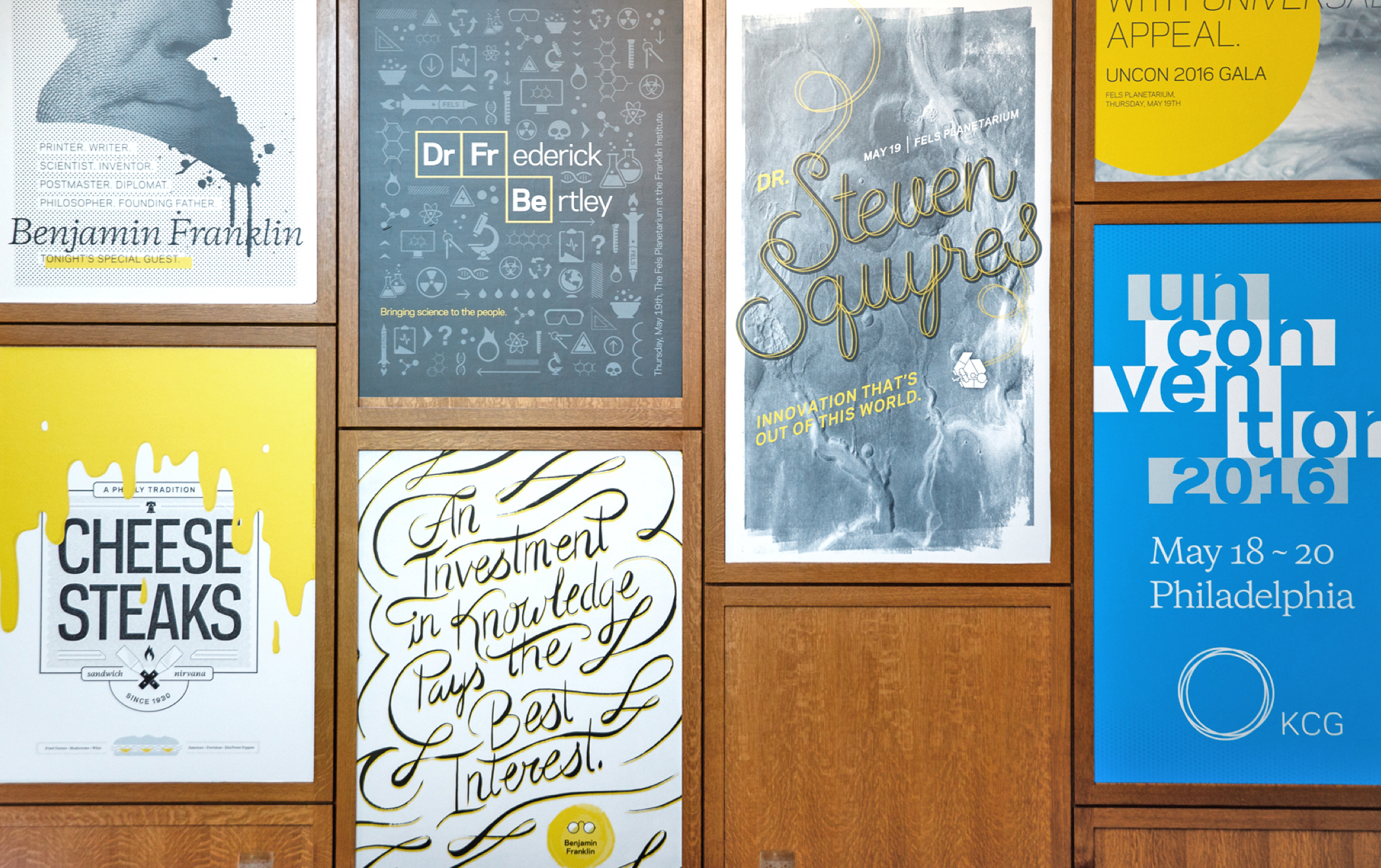 Several illustrated event posters on the wall of the meeting area at the 2016 KCG Uncon client event in Philadelphia.