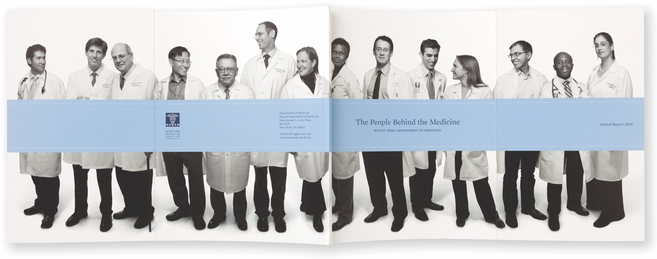 A wide black and white photo of 14 faculty members in lab coats spread across two pages of the 2009 Mount Sinai Department of Medicine Annual Report.