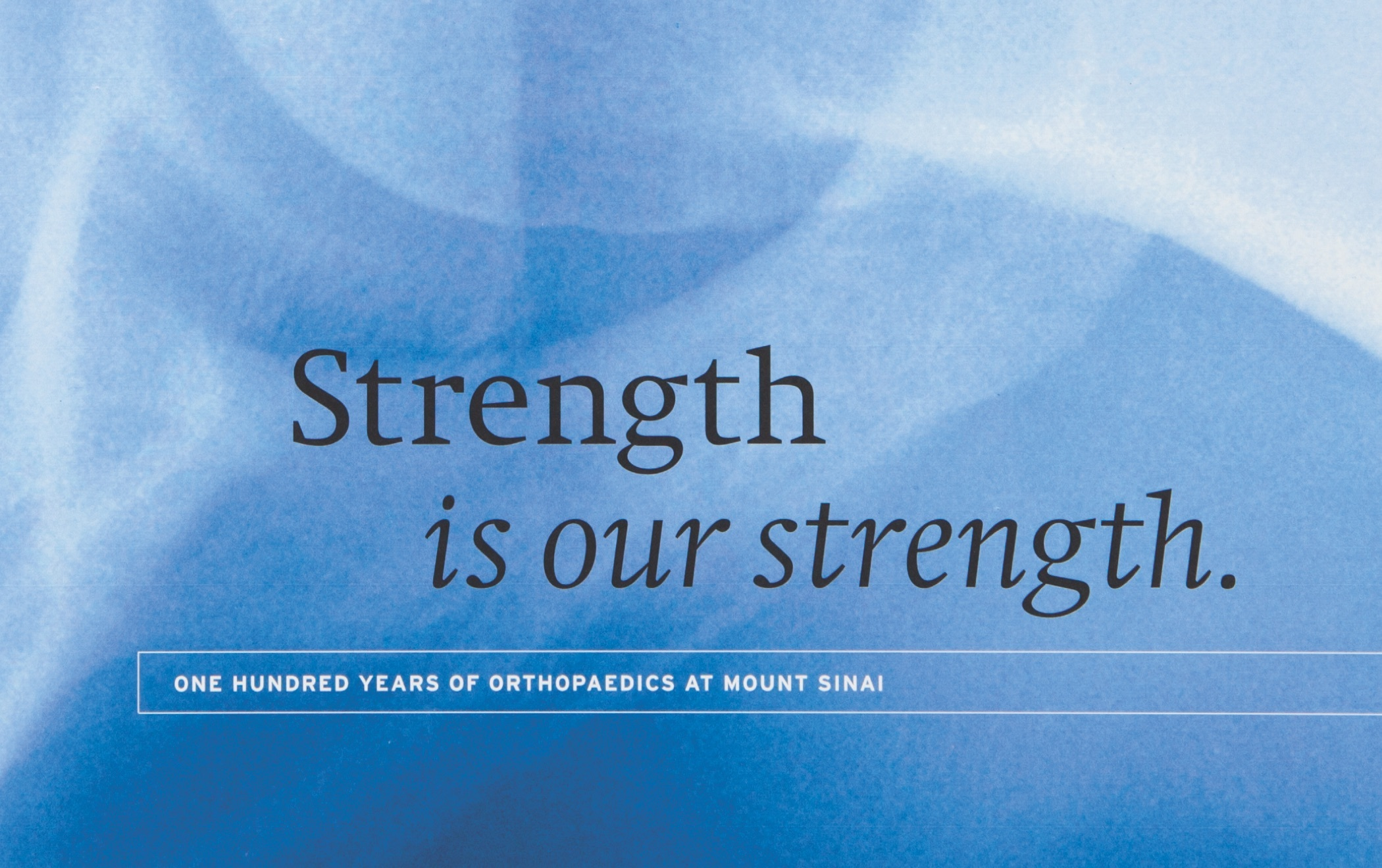 Detail from the cover the the Mount Sinai Orthopaedics Annual Report with the text, Strength is our strength: one hundred years of orthopaedics at Mount Sinai.