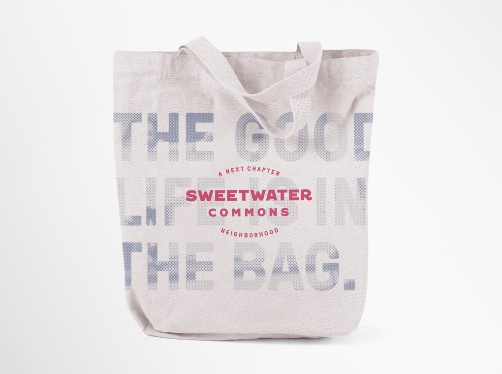 "A Sweetwater Commons branded tote bag printed with phrase ""The good life is in the bag."""