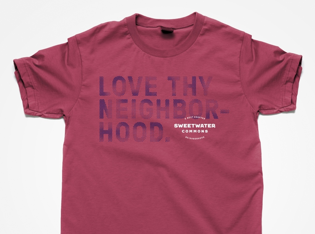 "A Sweetwater Commons branded t-shirt printed with phrase ""Love thy neighborhood."""