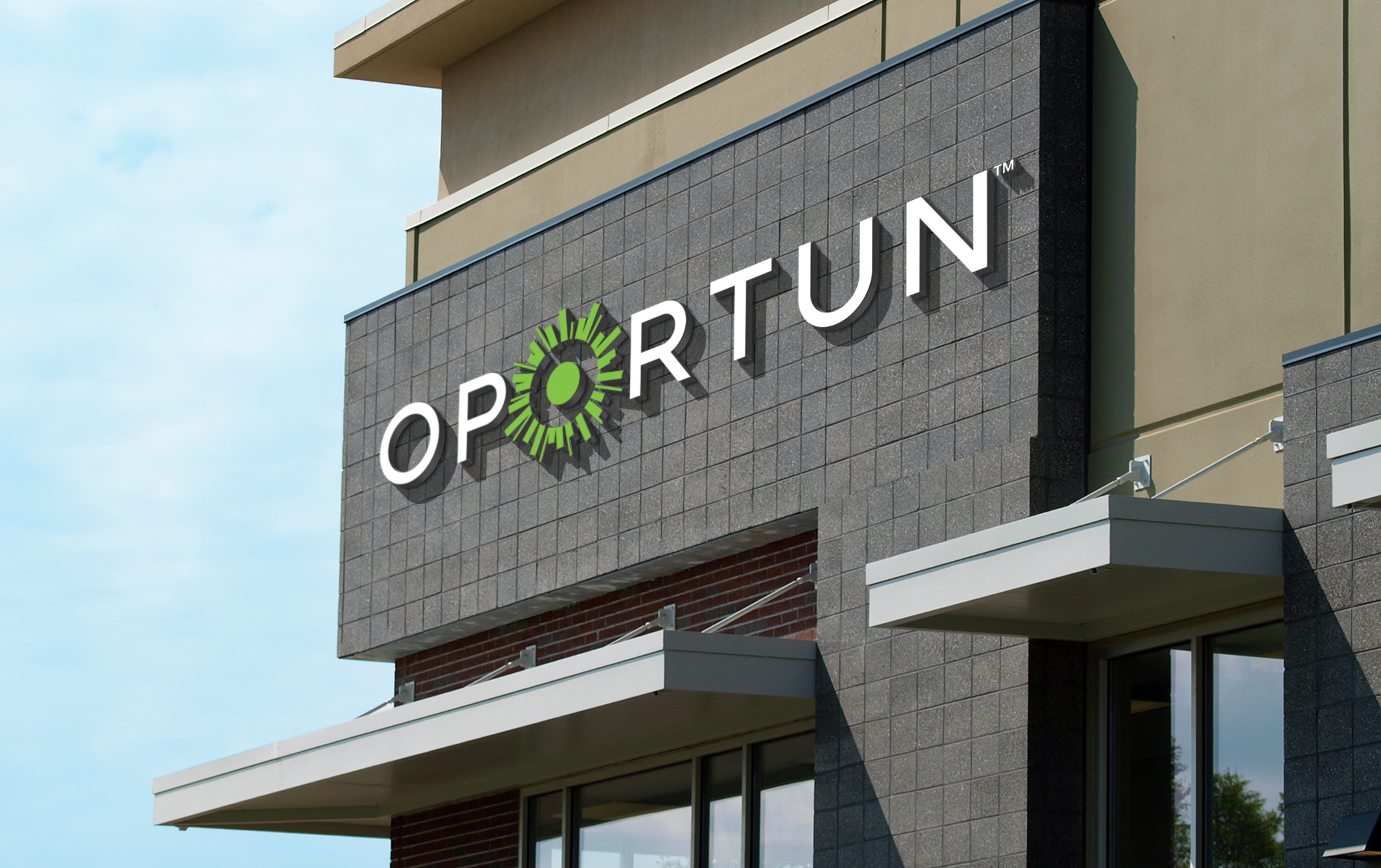 The Oportun logo on the large exterior sign on the company's headquarters.