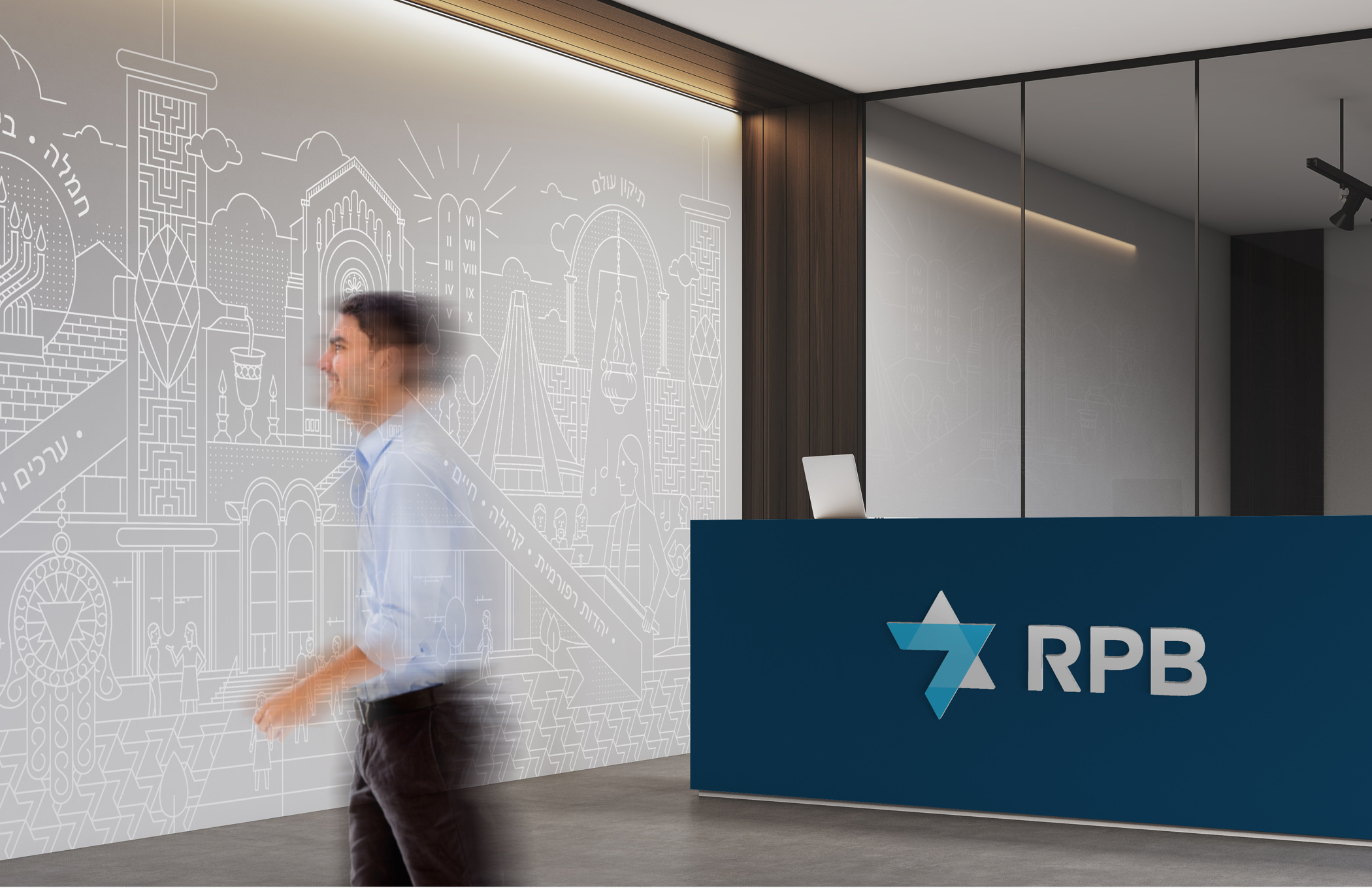 Thinkso.com_Alt-Text Thinkso.com_Alt-Text 100% 10  A man passes by a reception desk with the RPB logo and in front of a large mural depicting Jewish religious architecture. A man passes by a reception desk with the RPB logo and in front of a large mural depicting Jewish religious architecture.; Cell C41         A man passes by a reception desk with the RPB logo and in front of a large mural depicting Jewish religious architecture.