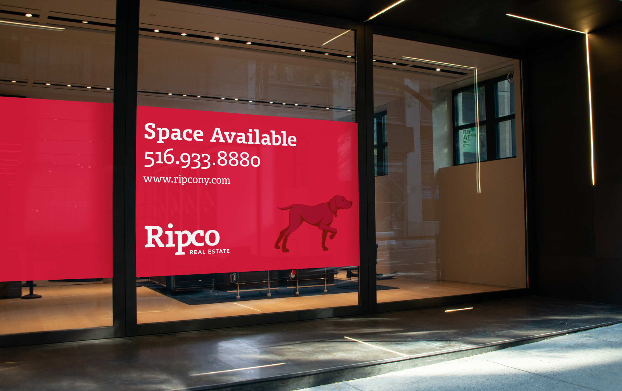 A large red window poster advertising available space with the Ripco logo and hunting-dog-in-a-pointer-pose symbol.