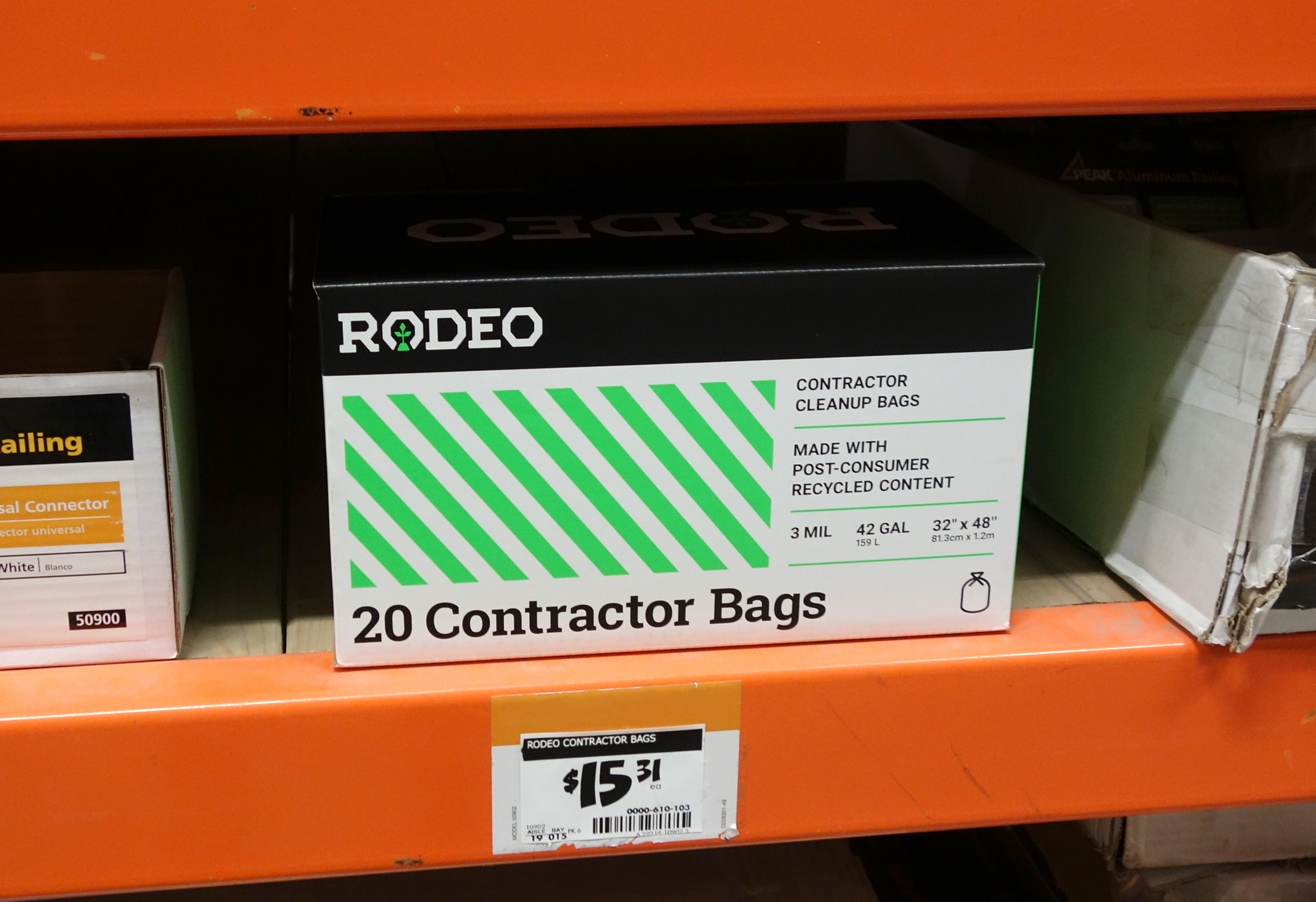 Front view of a Rodeo Plastics 20 contractor bag package on a shelf in a big-box retail store.