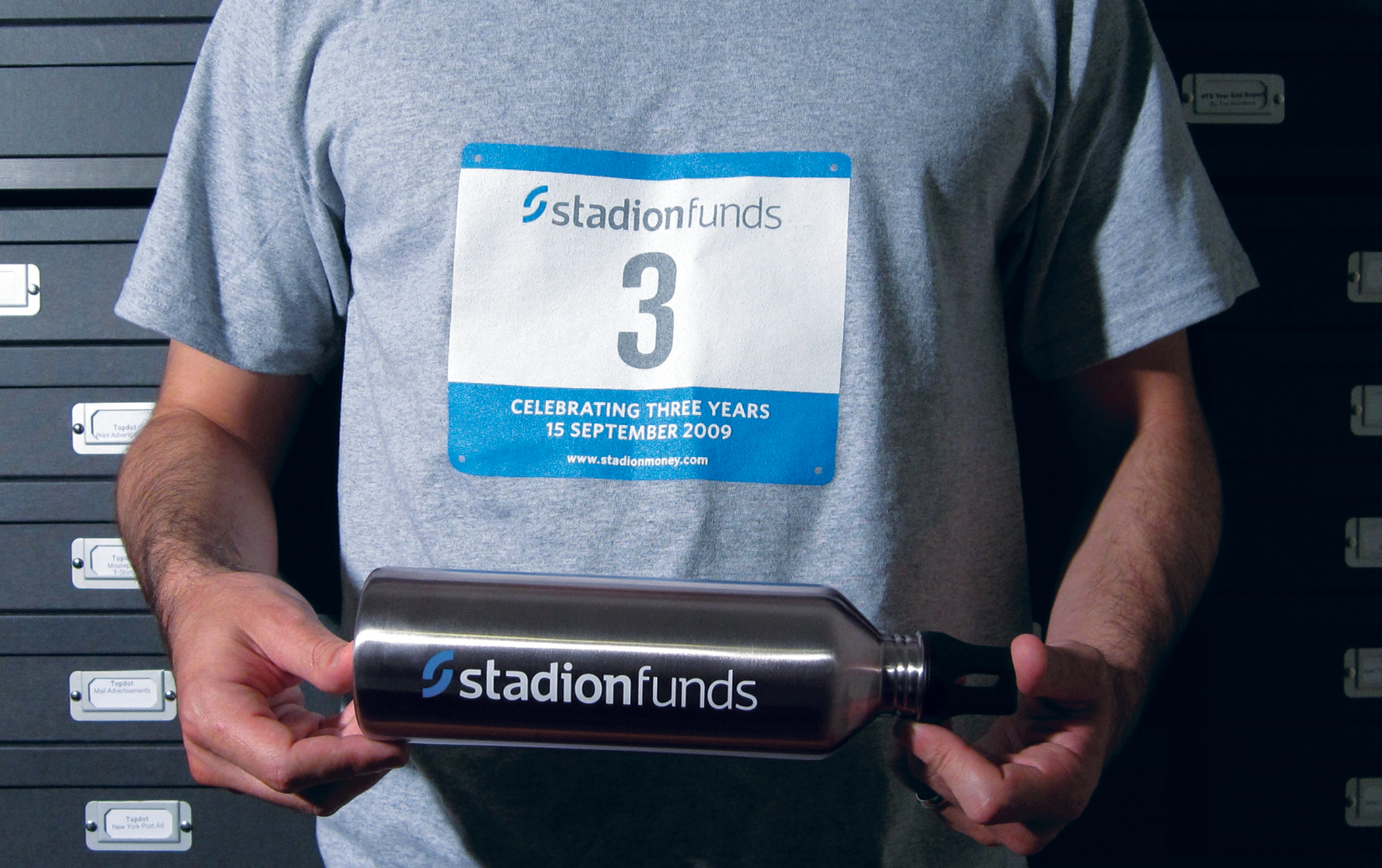 Stadion-branded promotional T shirt and water bottle.