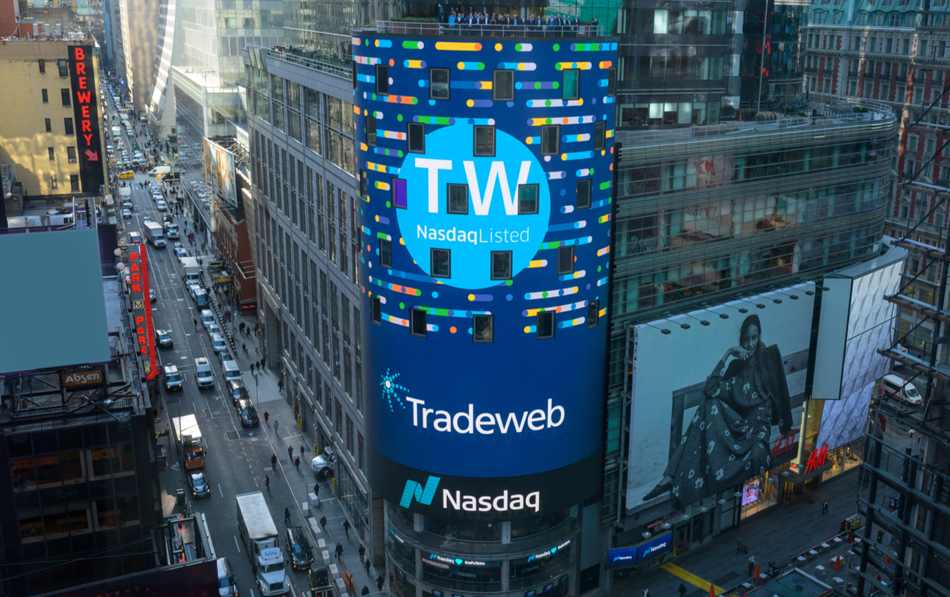 High wide shot of the the NASDAQ building in Times Square with the Tradeweb ticker and logo filling the building-high display