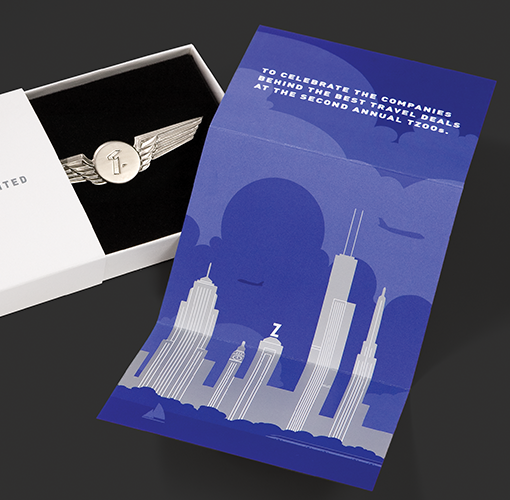 """A wing-shaped medal and a card commemorating the winners of Travelzoo's annual """"T zoos"""" travel awards."""
