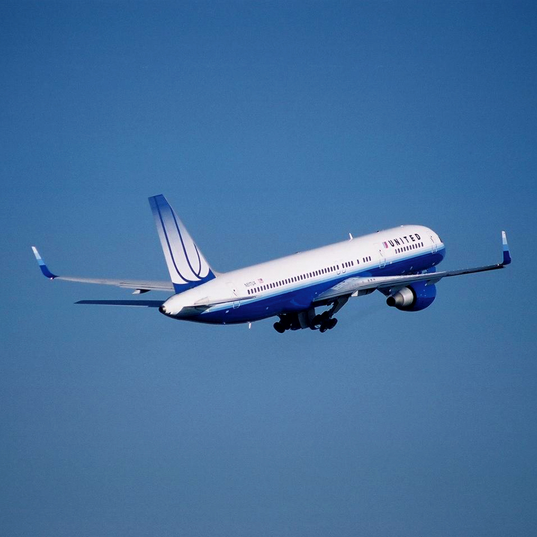 United Airlines aircraft in flight, just after taking off.