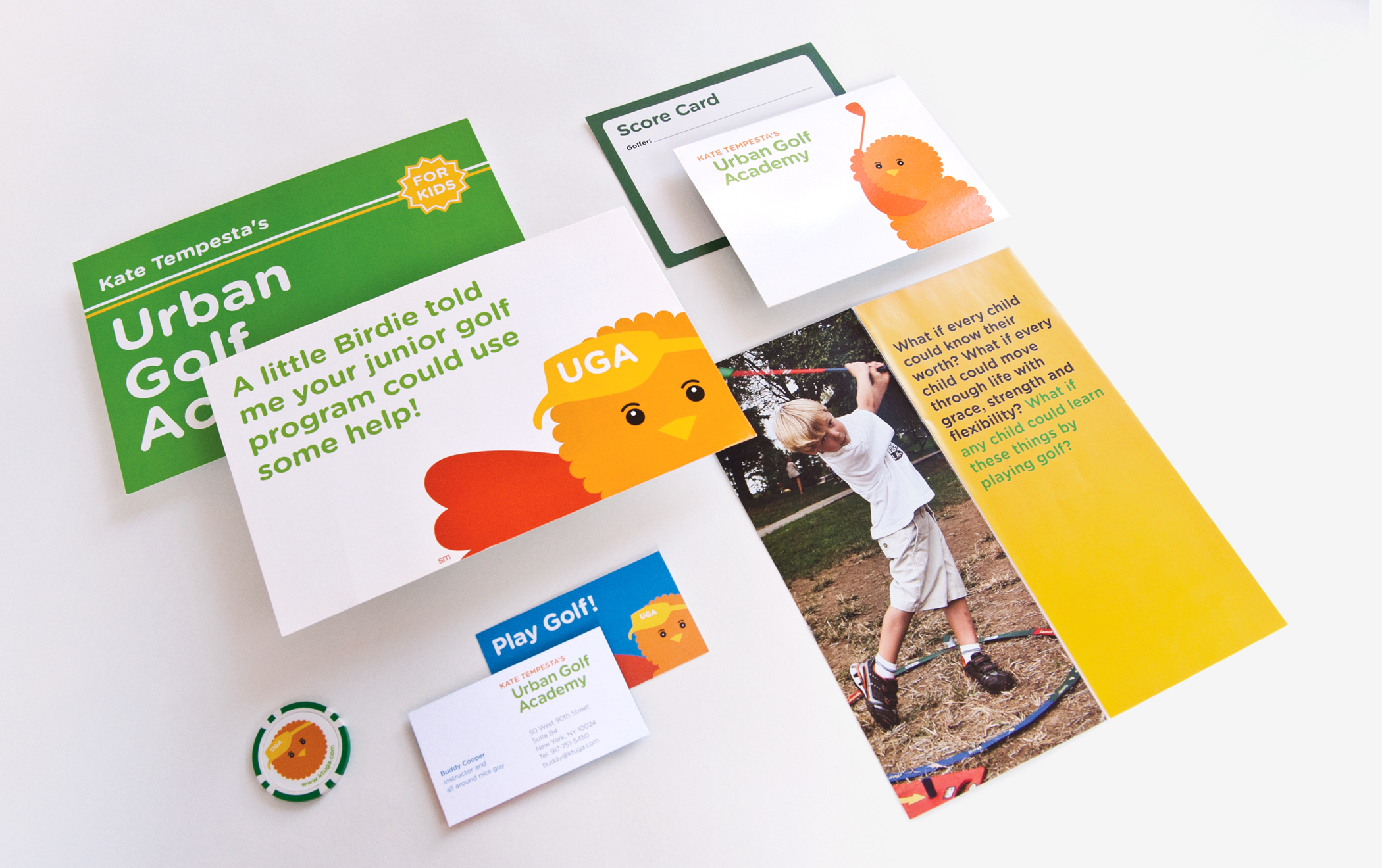 A variety of Urban Golf Academy marketing materials, including postcards, business cards, and a branded golf scorecard.