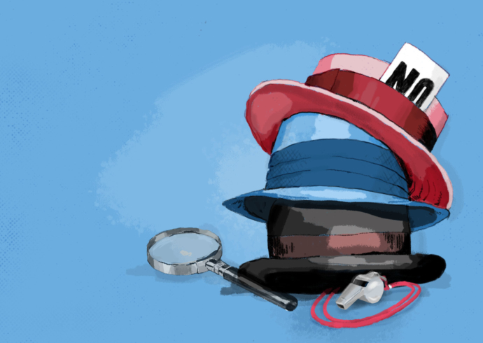 A stack of three hats rests next to a whistle and magnifying glass.