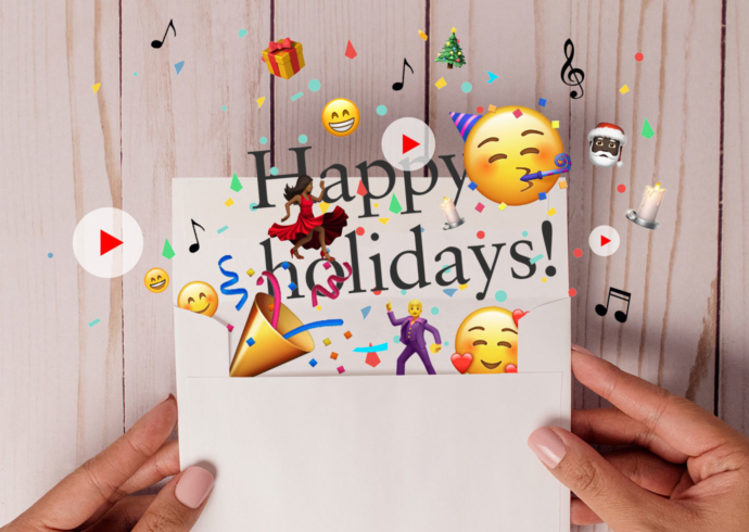 Hands holding an envelope with a holiday card and confetti, musical notes, and happy emojis coming out of it.