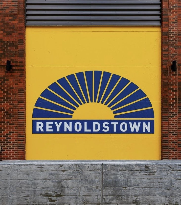 """Mural of a graphic sunburst with the work """"Reynoldstown"""" painted underneath"""
