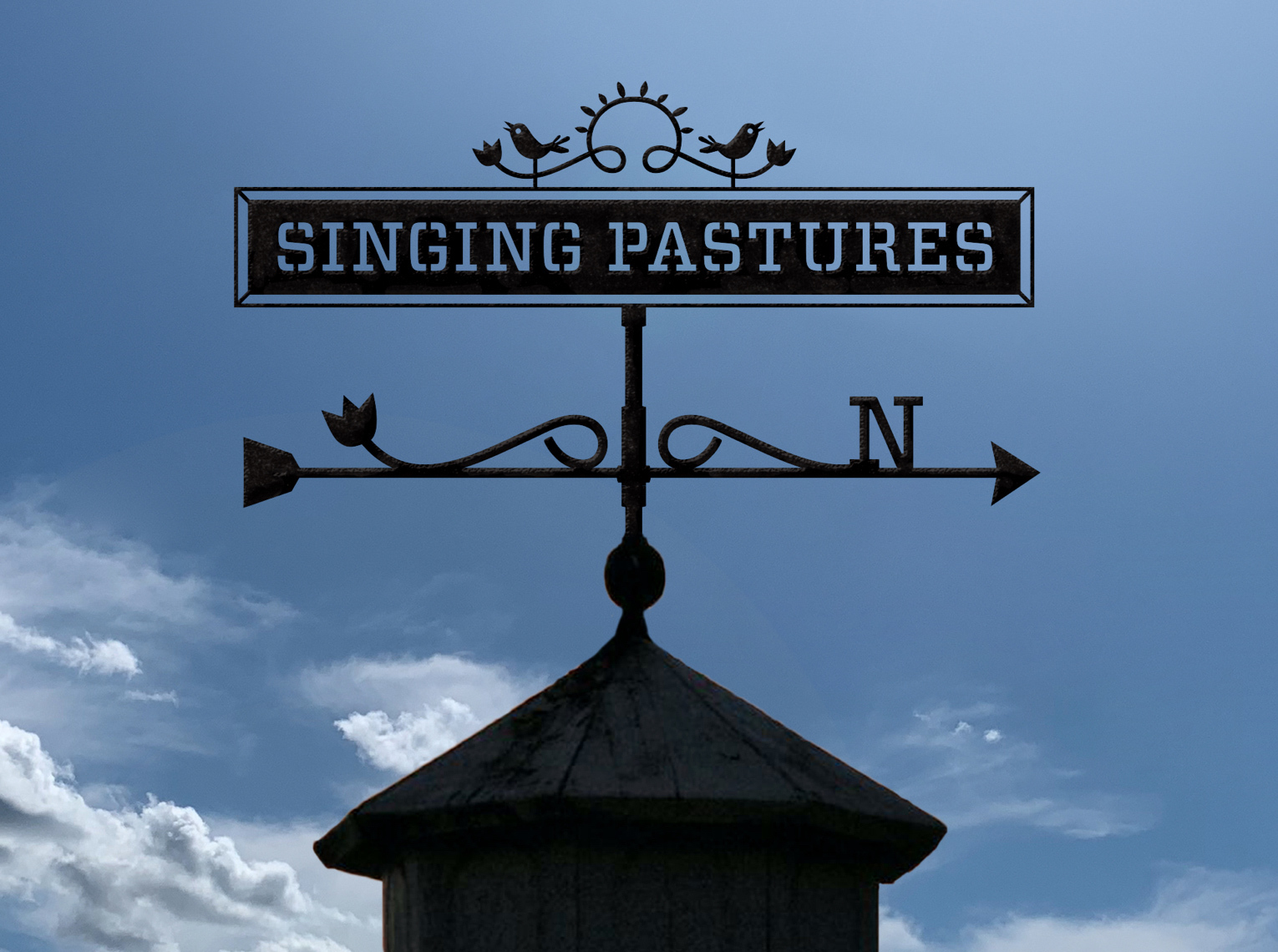 Close up the the Singing Pastures' logotype on a weathervane atop a barn.