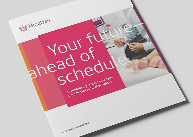 Close-up of Mindtree's company brochure resting on a table.